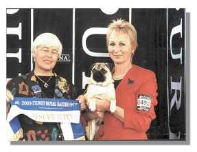 Esther with the judge and Ally after winning Puppy in group at the Sydney Royal Easter Show